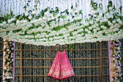 The fuchsia pink lehenga of the bride