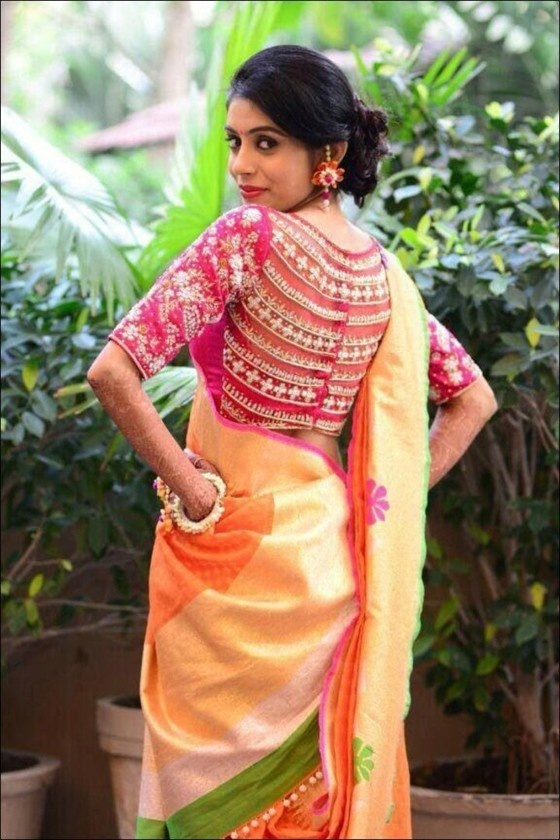 This Maggarm Work Blouse Of A Pattu Saree Is Done On Net Fabric And The Semi Circular Designs Provides Rich Feel To Otherwise Simple
