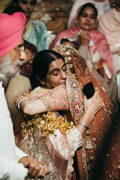 The bride and her mom sharing an emotional moment during the vidaai ceremony