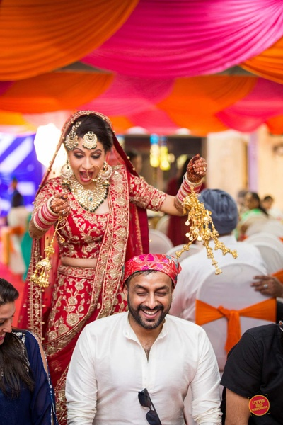 The bride having fun during her Sikh wedding