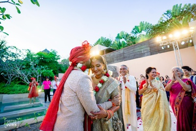 cute picture of the groom kissing the bride after the jaimala