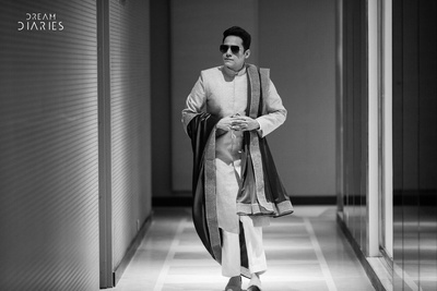 Black and white picture of the dashing groom