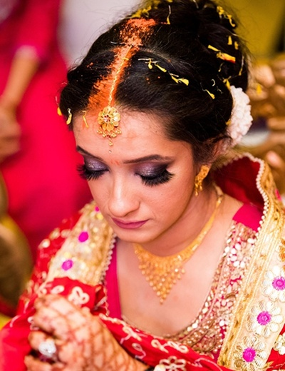 Candid picture of the bride during her pheras