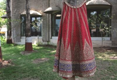Vasansi Jaipur's red dazzling lehenga furbishe with zardozi work, stone work and motifs