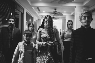 Bridal entry shot in black and white by photographer Naman Verma
