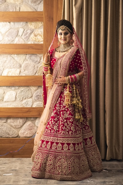 The bride looks like a million bucks in a heavily embellished lehenga paired with kundan jewellery.