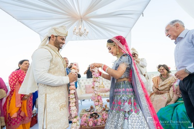 The bride and groom look elated before the jaimala ceremony.