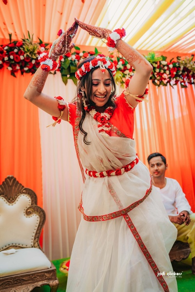 The gorgeous bride dancing at her haldi ceremony.