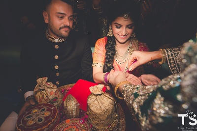 Pratishtha chose a orange and pink lehenga for her sagan ceremony while Shaun wore an all-black outfit
