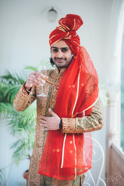 Gold and green dhoop chaaon wedding sherwani embellished with zari work