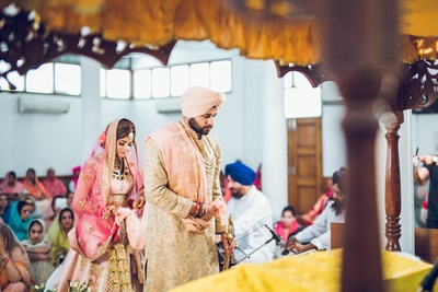 bride and groom in the gurudwara following the wedding rituals