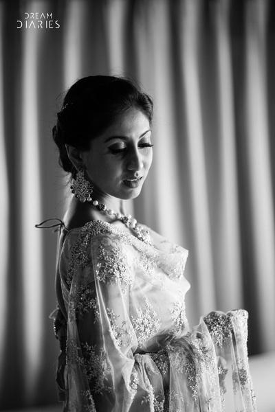 A black and white portrait of the bride