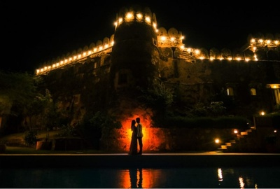 A creative and unique shot of the couple, using minimum lighting.