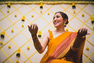 Candid picture of the bride at her haldi