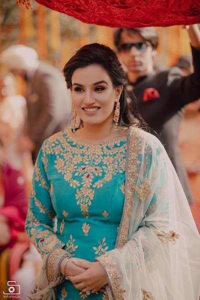 The bride looks like a million bucks in this ethnic embroidered blue lehenga!