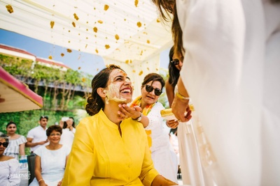 The family puts haldi on the adorable bride-to-be! Not miss her smile...
