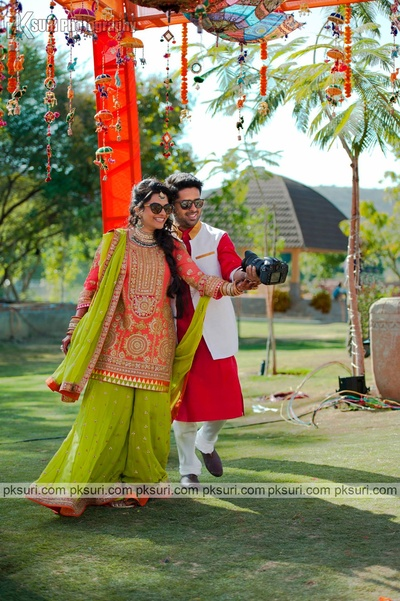 Fullsleeved coral kurta with gold embroidery paired with a Parrot green sharara embellished with gold sequins and a matching dupatta