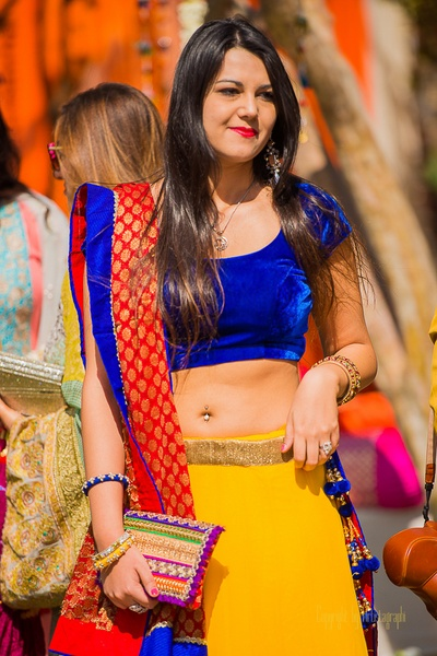 Cobalt blue and canary yellow designer lehenga embellished with latkans and styled with a red jamevar dupatta