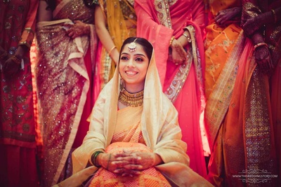 Ceremonial wedding photo of Krutika as she sits for her traditional haldi ceremony