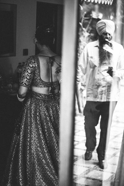 Emotional bridal photography ideas. Bride dressed in a Sabyasachi bridal lehenga