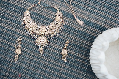 Heirloom gold necklace set studded with gemstones, beads and stone drops