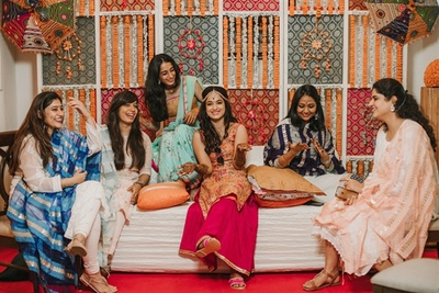 Bride with her bridesmaids during her mehendi