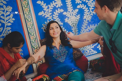 Wearing blue kurti with colorful embroidery on the yolk for her mehendi ceremony.