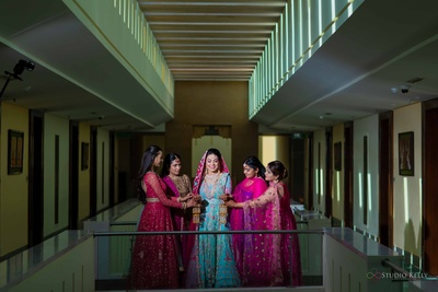 We are in love with the colour coordination of the bride and her bridemaids- pink and blue never looked so pretty!