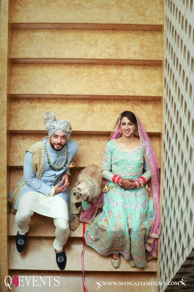 Bride and Groom posing for the photographer with their pet
