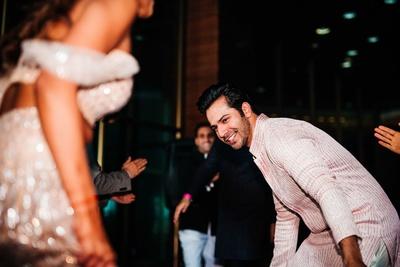 Varun Dhawan dancing with the bride