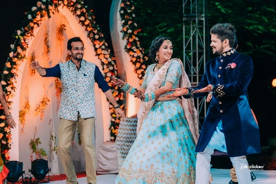 The couple grooving and having fun at their sangeet ceremony!