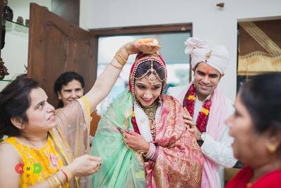 Shimmery silk maroon shawl for the Gruh-pravesh ceremony