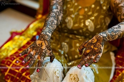 Arms filled in henna. Elongated and unique mehendi designs