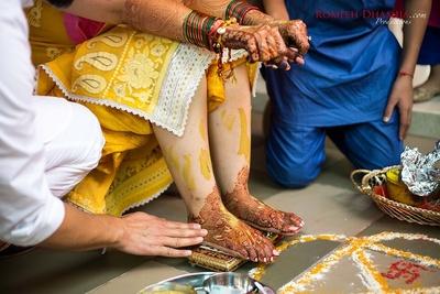 Family members putting haldi to the bride.