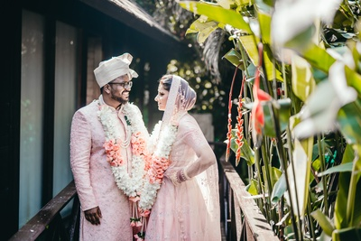 The bride and groom looked like a delight in their baby  pink coordinated outfits.