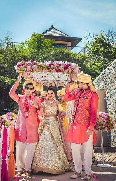Florally gorgeous bridal entry under phoolon ki chaadar.