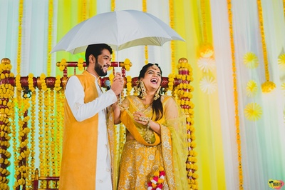 Candid picture of the couple at their haldi ceremony