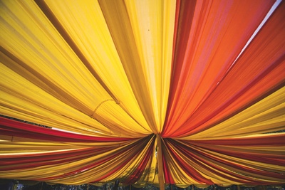 Yellow and orage draped ceiling decor