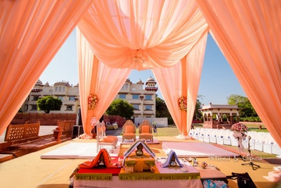Peach and white mandap decor by F5 Weddings for the wedding function at  Taj Jai Mahal Palace, Jaipur