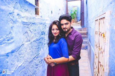 Dressed in complementing blue and purple outfits for their destination pre wedding photo shoot at  Hotel Jewel Palace, Jodhpur