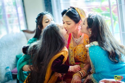 Kissed by her bridesmaids!