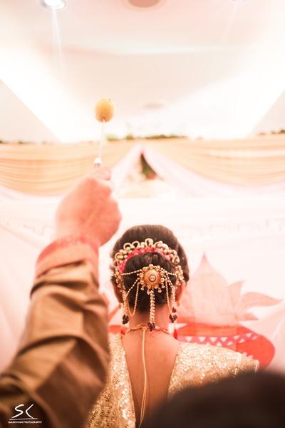 Bridal hairstyle adorned by ambada and juda pin