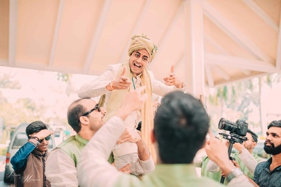 Groom dancing in his baraat as they proceed towards the wedding mandap
