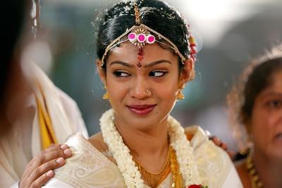 White silk bridal saree with gold woven textures