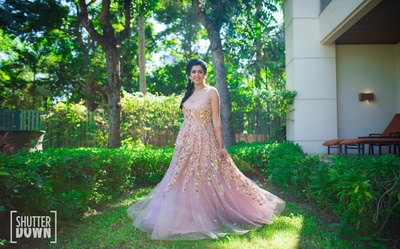 The bride in a pastel gown for the pool party