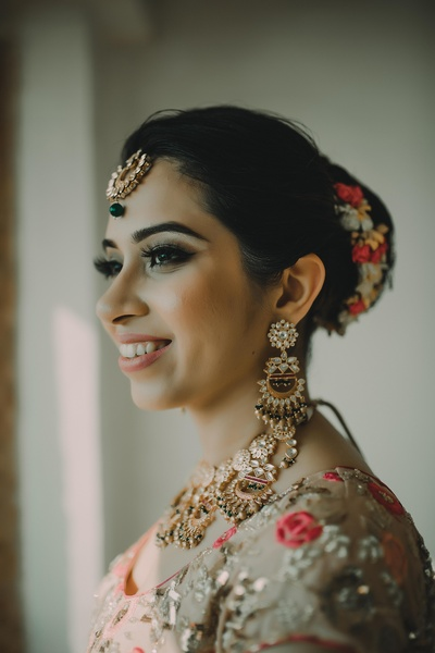 The bride looks absolutely gorgeous on her wedding day!