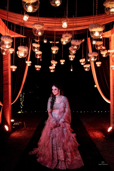 A beautiful click of the adorable bride coupled with some eye-catchy ceiling decor!