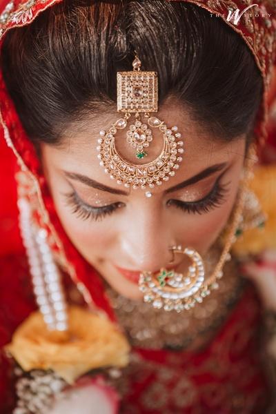 a unique chandbali maang tika worn by the bride