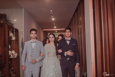 The bride enters her pre-wedding function along with her siblings