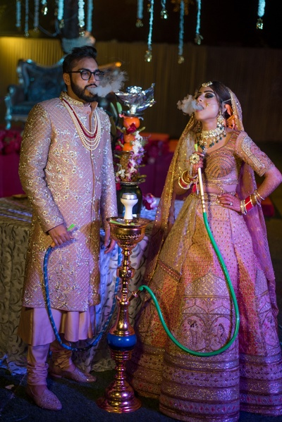 The super-cool bride and groom smoking hookah during their wedding ceremony.